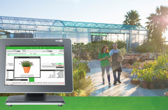 garden cpc 2 people walking with mobile pos