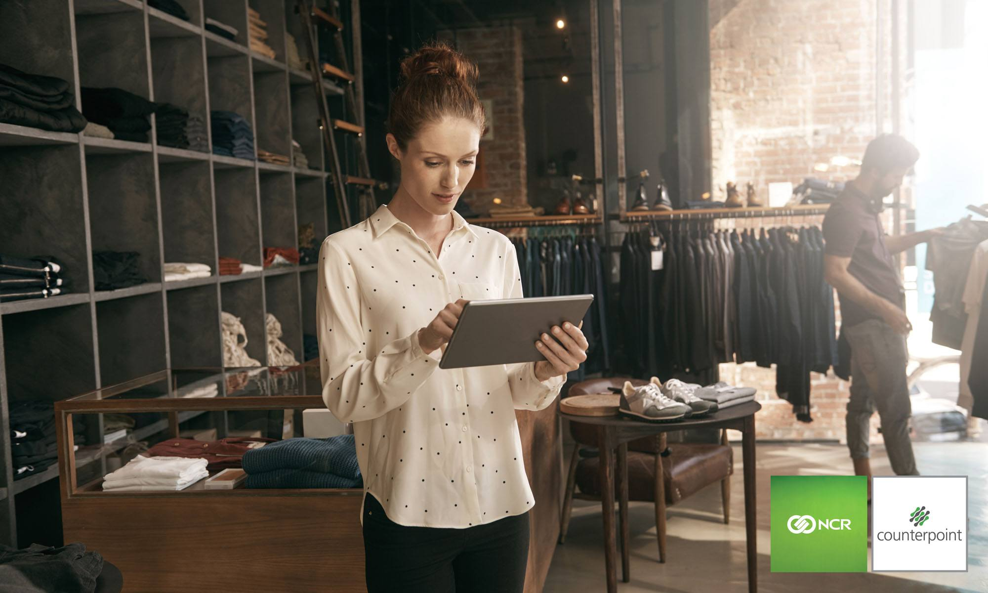 woman holding pos tablet counterpoint integration to ecommerce apparel